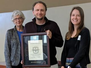 Professor David Schulz (center) with his student Abigail Beckerdite (right) and Ann Covington (left), the award's namesake.