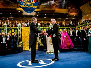 George Smith receiving his Nobel Prize
